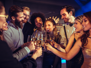 Young-people-toasting-in-a-nightclub[1]